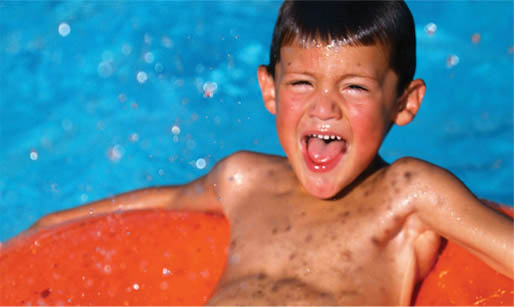 Child on pool inflatable